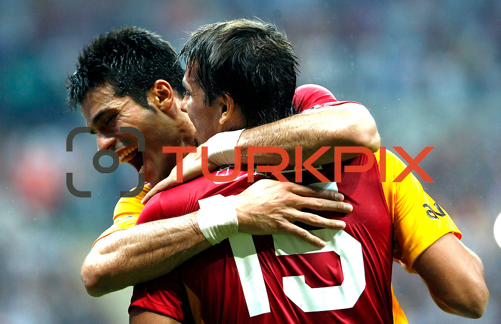 Galatasaray's Gokhan ZAN (L) during their Friendly soccer match Galatasaray between Liverpool at the TT Arena at Arslantepe in Istanbul Turkey on Saturday 28 July 2011. Photo by TURKPIX