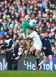 England's Anthony Watson and Ireland's Simon Zebo jump for possession in the air - Photo mandatory by-line: Ken Sutton/JMP - Mobile: 07966 386802 - 01/03/2015 - SPORT - Rugby - Dublin - Aviva Stadium - Ireland v England - Six Nations