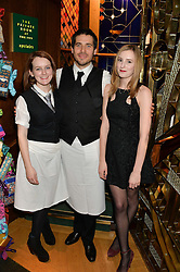 Left to right, SOPHIE McSHERA, ROBERT JAMES-COLLIER and LAURA CARMICHAEL at One Night Only at The Ivy in aid of Acting For Others supported by Tanqueray No.TEN Gin at The Ivy, 1-5 West Street, London on 1st December 2013.