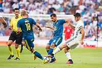"Real Madrid's player Marco Asensio and Celta de Vigo's player Jonathan Castro ""Jonny"" during a match of La Liga Santander at Santiago Bernabeu Stadium in Madrid. August 27, Spain. 2016. (ALTERPHOTOS/BorjaB.Hojas)"