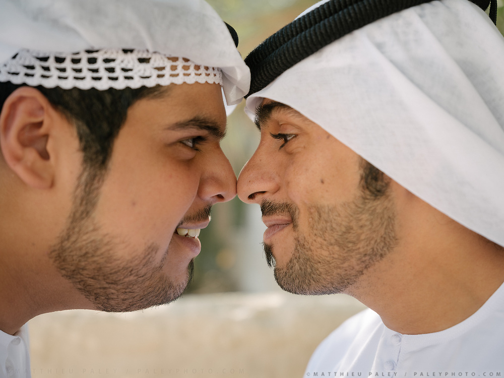 Touching each others nose is the traditional greeting between men in the Emirates.