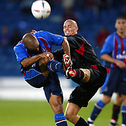 Charlton's  Paul Konchesky and Crystal Palace's Curtis Fleming battle for the ball