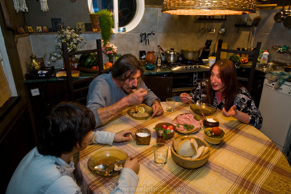 Art restorer Vyacheslav Grankovskiy eats dinner with his family in the kitchen of their home in Schlisselburg, outside St. Petersburg, Russia. (Vyacheslav Grankovskiy is featured in the book What I Eat: Around the World in 80 Diets.)  MODEL RELEASED.