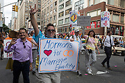 Maromons for Marriage Quality carry a variety of signs.