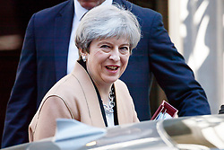 © Licensed to London News Pictures. 19/04/2017. London, UK. Prime Minister THERESA MAY leaves Downing Street to attend Prime Minister's Question Time in House of Commons in London on 14 April 2017, the morning after she announced plans for a snap general election. Photo credit: Tolga Akmen/LNP