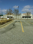 The parking lot in front of closed stores at Towson Mall