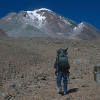 An expedition led by archaeologist Dr. Johan Reinhard hikes up the slopes of 22,110-foot Volcan Llullaillaco in northern Argentina, where they later found the world's highest mummies from an ancient Inca sacrifice.