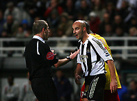 Photo: Andrew Unwin.<br />Newcastle United v Watford. The Barclays Premiership. 16/12/2006.<br />Newcastle's Antoine Sibierski (R) argues with the referee, Martin Atkinson (L).
