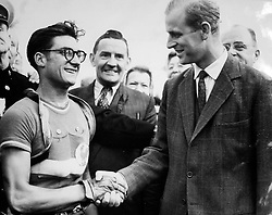 File photo dated 13/08/1948 of the Duke of Edinburgh shaking hands with Jose Beyaert of France who won the 20-mile cycle road race at Windsor. Prince Philip's final public engagement takes place on Wednesday, before he retires at the age of 96.