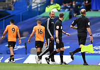 Football - 2019 / 2020 Premier League - Chelsea vs. Wolverhampton Wanderers<br /> <br /> Wolverhampton Wanderers manager Nuno Espirito Santo frustrated with Referee Stuart Attwell at the half time whistle, at Stamford Bridge.<br /> <br /> COLORSPORT/ASHLEY WESTERN