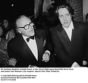 Sir Anthony Hopkins & Hugh Grant  at the  Oscar Night party hosted by Steve Tisch and Vanity Fair. Morton's. Los Angeles. March 1995. Film. 95548/25a<br />© Copyright Photograph by Dafydd Jones<br />66 Stockwell Park Rd. London SW9 0DA<br />Tel 0171 733 0108