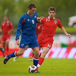 REYKJAVIK, ICELAND - Wednesday, May 28, 2008: Wales' Ched Evans and Iceland's Eggert Gunnthor Jonsson during the international friendly match at the Laugardalsvollur Stadium. (Photo by David Rawcliffe/Propaganda)