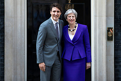 © Licensed to London News Pictures. 18/04/2018. London, UK. Prime Minister of Canada Justin Trudeau (L) and Prime Minister Theresa May (R) outside 10 Downing Street. Photo credit: Rob Pinney/LNP