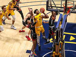 Jan 25, 2021; Morgantown, West Virginia, USA; West Virginia Mountaineers forward Derek Culver (1) shoots in the lane among many Texas Tech Red Raiders defenders during the second half at WVU Coliseum. Mandatory Credit: Ben Queen-USA TODAY Sports
