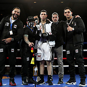 Pablo Valdez and his team celebrate a victory over Devon Grant during a One For All Promotions boxing event at the Caribe Royale Orlando Events Center on Saturday, February 20, 2021 in Orlando, Florida. (Alex Menendez via AP)