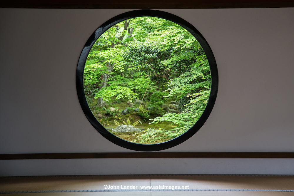 """Genko-an garden plants and stones are arranged to create an elegant world of wabi and sabi,<br /> The temple is famous for two large windows.  """"The Window of Enlightenment"""" is round, showing the harmony of the universe.  The squared window is called """"The Window of Confusion"""" symbolising humans' lives of suffering.  Both windows overlook the same garden, though the effect of looking through each window is quite different.  Genko-an Temple was originally built as a hermitage for the head priest of Daitoku-ji Temple, but was in time turned into a temple of the Soto sect of Zen Buddhism."""