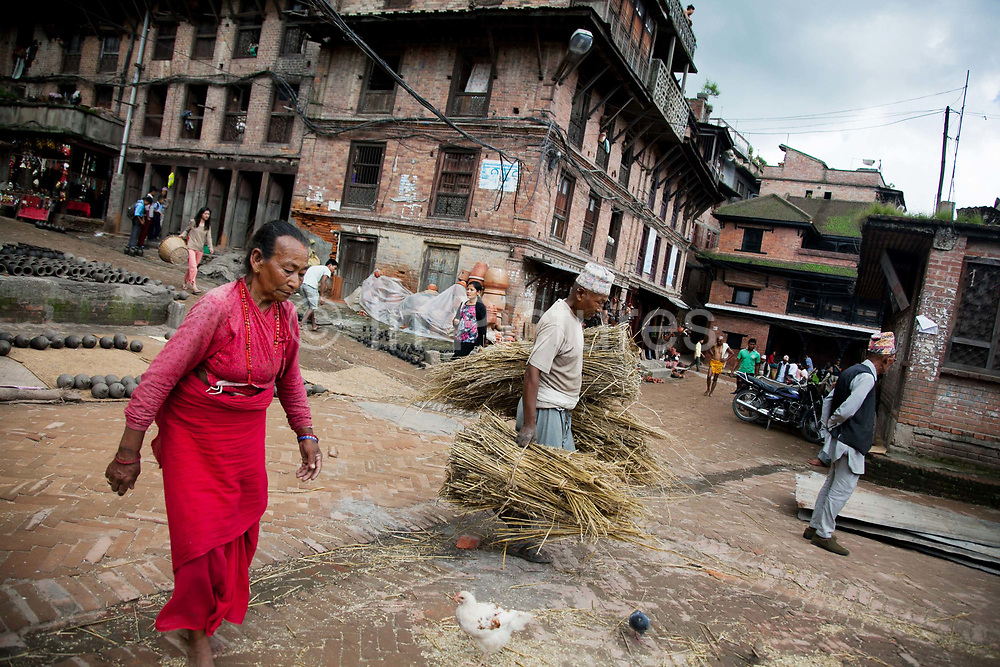 Pottery making is one of Bhaktapur's traditional industries and the pots are laid out in this little square to dry before going into the oven to be burned.