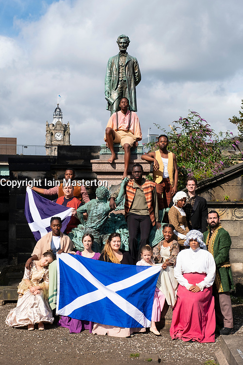Edinburgh, Scotland, UK; 1 August, 2018. The cast of Henry Box Brown: a Musical Journey at the statue of President Lincoln in the Old Calton Burial Ground, Edinburgh. New York Gospel singers from a new Edinburgh Fringe musical about an American slave shipped to freedom in a 3ftX2ft box gather at American Civil War Memorial to honour the Scots who fought against slavery in the American Civil War.