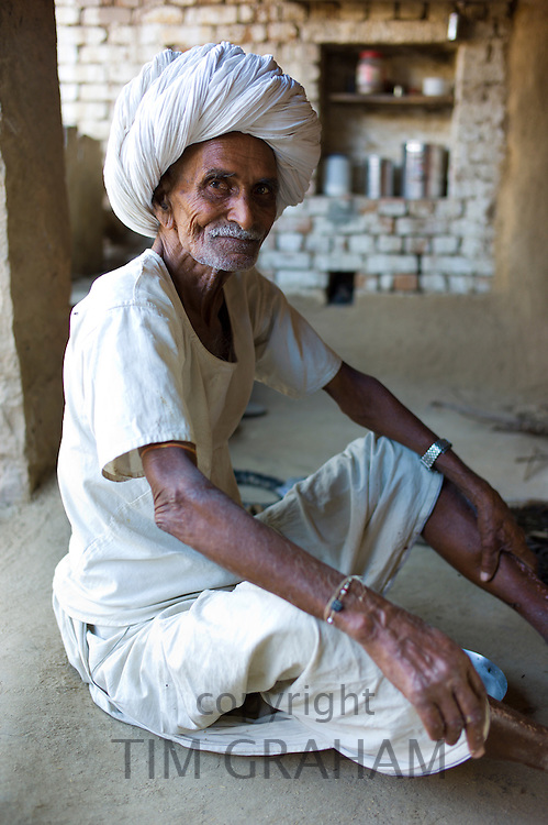 Indian man at home in Narlai village in Rajasthan, Northern India