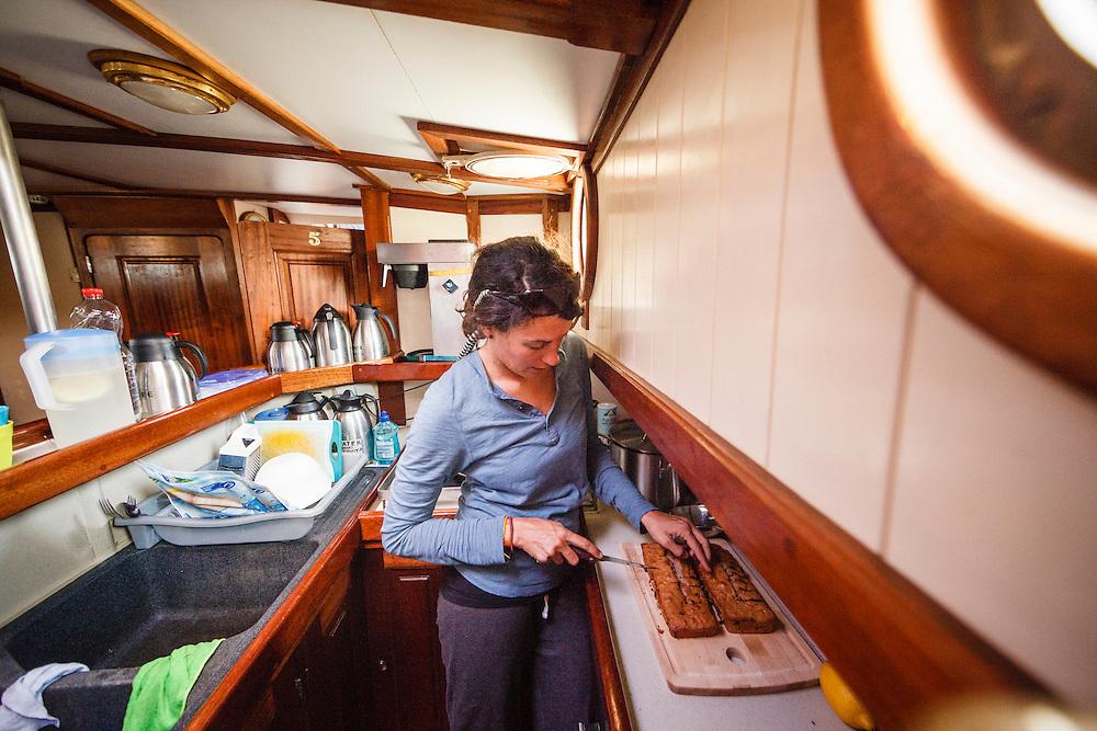 Henrike Elbert prepares desset for the crew of the Anne-Margaretha.