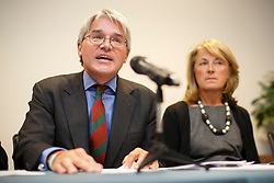 "© licensed to London News Pictures. London, UK 26/11/2013. Former chief whip Andrew Mitchell and his wife Dr Sharon Bennett give their reactions to the CPS decision to charge a police officer with misconduct in public office as a result of the ""Plebgate"" row at a press conference at Kingsley Napley office in London. Photo credit: Tolga Akmen/LNP"
