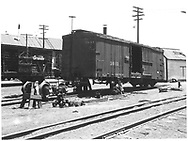 Box car #3011 on RIP track with B-end truck removed.<br /> D&RGW    ca 1959