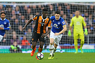Alfred N'Diaye of Hull City gets away from Gareth Barry of Everton. Premier league match, Everton v Hull city at Goodison Park in Liverpool, Merseyside on Saturday 18th March 2017.<br /> pic by Chris Stading, Andrew Orchard sports photography.