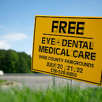 A placard advertises the Remote Area Medical clinic in Wise, Virginia July 20, 2012.  Organizers hope to bring free medical, dental and vision care to more than 3500 uninsured and underinsured people in the rural Virginia area.