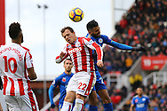 Xherdan Shaqiri of Stoke City and Riyad Mahrez of Leicester City jump for the ball. Premier league match, Stoke City v Leicester City at the Bet365 Stadium in Stoke on Trent, Staffs on Saturday 4th November 2017.<br /> pic by Chris Stading, Andrew Orchard sports photography.
