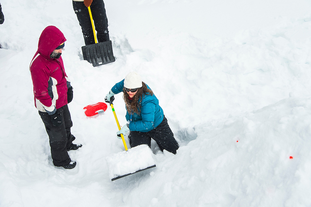 Participants in the Michigan DNR Becoming an Outdoors Woman program learn to build a quinzhee winter shelter at Bay Cliff Health Camp in Big Bay, Michigan.