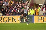 Twickenham, Surrey. England, UK.,02.05.2003,  Nathan WILLIAMS,  kicking the ball on the run,  Zurich Premiership Rugby match, Harlequins v Northampton Saints, played at the Stoop Memorial Ground, [Mandatory Credit:Peter Spurrier/ Intersport Images]