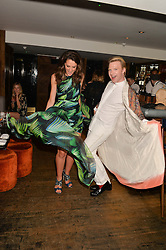 ROSANNA FALCONER and HENRY CONWAY at the launch of Geisha at Ramusake hosted by Piers Adam and Marc Burton at Ramusake, 92B Old Brompton Road, London on 11th June 2015.