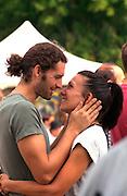 Romantic couple age 23 participating in the Cedarfest Summer Music Festival.  Minneapolis Minnesota USA