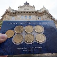 75th anniversary commemorative boxed coin set displaying the text Forint name of the Hungary currency is seen in front of the building of the National Bank that appears on the design of the coins in Budapest, Hungary on Aug. 6, 2021. ATTILA VOLGYI