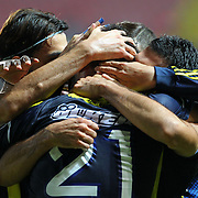 Fenerbahce's (C) Selcuk Sahin, (L) Mehmet Topal, (R) Bekir irtegun celebrates his goal during their Turkish Super League soccer match Akhisar Belediyespor between Fenerbahce at the 19 Mayis Stadium  in Manisa Turkey on Saturday, 03 November 2012. Photo by TURKPIX