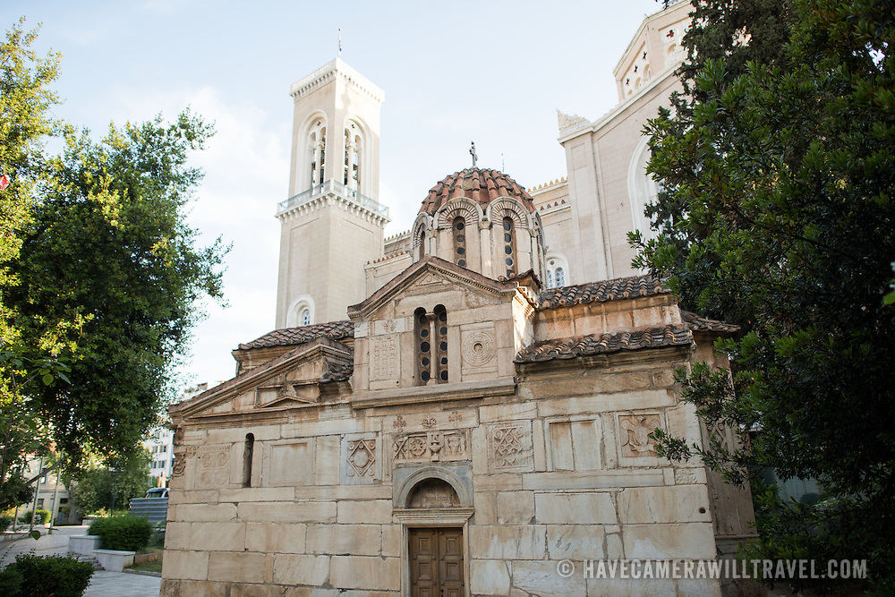 Dating back to the 13th century, the tiny Agios Eleftherios Church (also known as Mikri Mitropoli) sits next to the much larger Metropolitan Cathedral of Athens 9in the background).