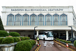 © Licensed to London News Pictures. 16/02/2021. LONDON, UK.  An exterior view of the Radisson Blu Hotel at Heathrow where travellers are staying for a quarantine stay.  Effective 15 February, arrivals at Heathrow from a 'Red List' of 33 countries must book a £1,750 per adult package in a hotel for ten days as the government seeks to limit the spread of coronavirus variants arriving from abroad.  Once through airport protocols, security guards transport the arrivals by bus to hotels designated for the quarantine stay.  Photo credit: Stephen Chung/LNP