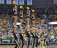 WICHITA, KS - NOVEMBER 12:  Wichita State Shockers cheerleaders perform during a game against the Western Kentucky Hilltoppers on November 12, 2013 at Charles Koch Arena in Wichita, Kansas.  (Photo by Peter Aiken/Getty Images) *** Local Caption ***