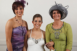 Bride who has cerebral palsy, with mother and sister at wedding ceremony.