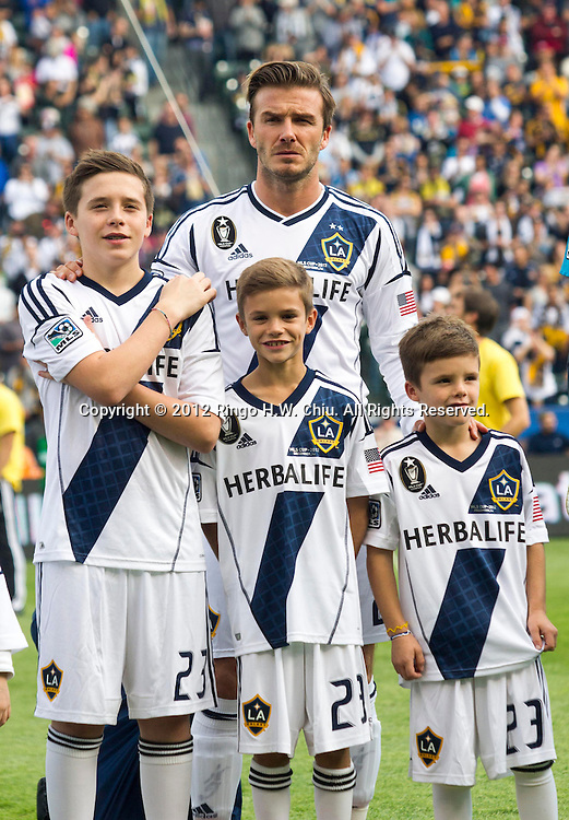 Los Angeles Galaxy star David Beckham #23 with his sons Brooklyn Beckham, Romeo Beckham and Cruz Bekham before his farewell game in the Major League Soccer (MLS) Cup final at the Home Depot Center on December 1, 2012 in Carson, California. The Galaxy defeated Houston Dynamo 3-1 to win the MLS Cup Championship. Beckham will be leaving the team after the game. He joined the L.A. Galaxy back on January 11, 2007, when he signed a 5-year contract worth $32.5million. He has played in over 98 games during his six season stint with the Galaxy and just last season was named an MLS all-star while notching a career best 15 assists in MLS play. (Photo by Ringo Chiu/ PHOTOFORMULA.com)..