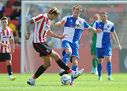 Chris Lines of Bristol Rovers challenges Billy Waters of Cheltenham Town for the ball - Mandatory by-line: Dougie Allward/JMP - 25/07/2015 - SPORT - FOOTBALL - Cheltenham Town,England - Whaddon Road - Cheltenham Town v Bristol Rovers - Pre-Season Friendly