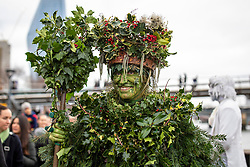 © Licensed to London News Pictures. 05/01/2020. London, UK. The Holly Man as performers mark Twelfth Night, an annual celebration the New Year, on Bankside in London. Photo credit: Rob Pinney/LNP