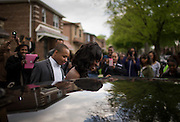 Family and friends take photographs as Nailah Bradley and date Daniel Jackson step into their rented car at her South Shore home after their prom send-off party Saturday, May 17, 2014. (Brian Cassella/Chicago Tribune) B583716572Z.1  ....OUTSIDE TRIBUNE CO.- NO MAGS,  NO SALES, NO INTERNET, NO TV, CHICAGO OUT, NO DIGITAL MANIPULATION...