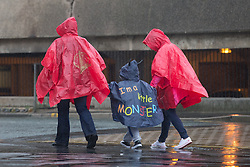 © Licensed to London News Pictures . 17/06/2015. Blackpool  , UK . People wearing ponchos in the rain . Rain and fog over Blackpool today ( Wednesday 17th June 2015 ) . Photo credit : Joel Goodman/LNP