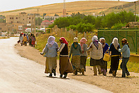 Women with head scarfs walking, Bulla Regia, Tunisia