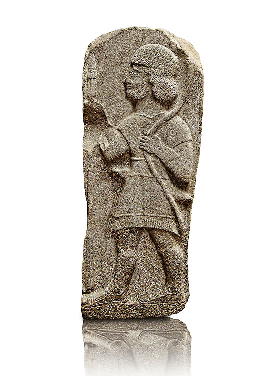 Late Hittite Basalt funereal Steel with a relief sculpture of a warrior from 9 - 8th Cent B.C, excavated from Arslan Tash (Turkish; Arslan Lion, Taş Stone), ancient Hadātu, is an archaeological site in northern Syria 30km east of the Euphrates River and nearby the town of Ain al-Arab. Istanbul Archaeological Museum Inv. No 1981. .<br /> <br /> If you prefer to buy from our ALAMY STOCK LIBRARY page at https://www.alamy.com/portfolio/paul-williams-funkystock/hittite-art-antiquities.html - Type - Arsian   - into the LOWER SEARCH WITHIN GALLERY box. Refine search by adding background colour, place, museum etc<br /> <br /> Visit our HITTITE PHOTO COLLECTIONS for more photos to download or buy as wall art prints https://funkystock.photoshelter.com/gallery-collection/The-Hittites-Art-Artefacts-Antiquities-Historic-Sites-Pictures-Images-of/C0000NUBSMhSc3Oo