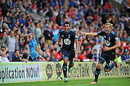 Paulinho (l) celebrates his winning goal for Tottenham Hotspur with team mate Harry Kane.<br /> Barclays Premier league match, Cardiff city v Tottenham Hotspur at the Cardiff city Stadium in Cardiff, South Wales on Sunday 22nd Sept 2013. pic by Phil Rees/ Andrew Orchard sports photography.