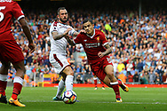 Philippe Coutinho of Liverpool (r) looks to go past Steven Defour of Burnley. Premier League match, Liverpool v Burnley at the Anfield stadium in Liverpool, Merseyside on Saturday 16th September 2017.<br /> pic by Chris Stading, Andrew Orchard sports photography.