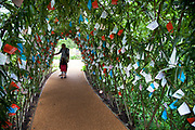 London 2012 Olympic Park in Stratford, East London. Under an archway in one of the gardens, thousands of messages of good will and good lick have been tied on.