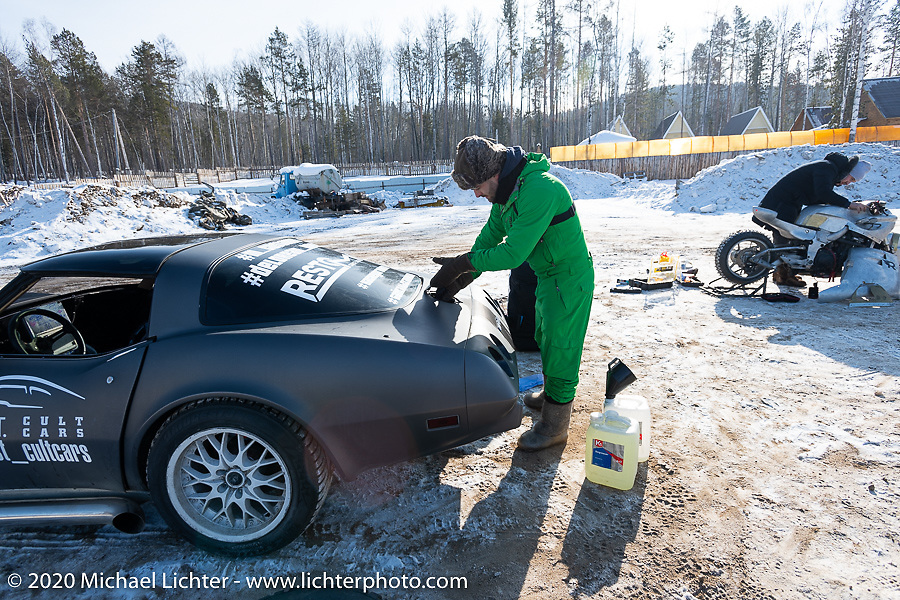 Anton Skrypnikov of the Moscow based MostCultCars Auto Museum with the LSR powered 1979 Chevrolet Corvette he was prepping before the start of the Baikal Mile Ice Speed Festival. Maksimiha, Siberia, Russia. Tuesday, February 25, 2020. Photography ©2020 Michael Lichter.